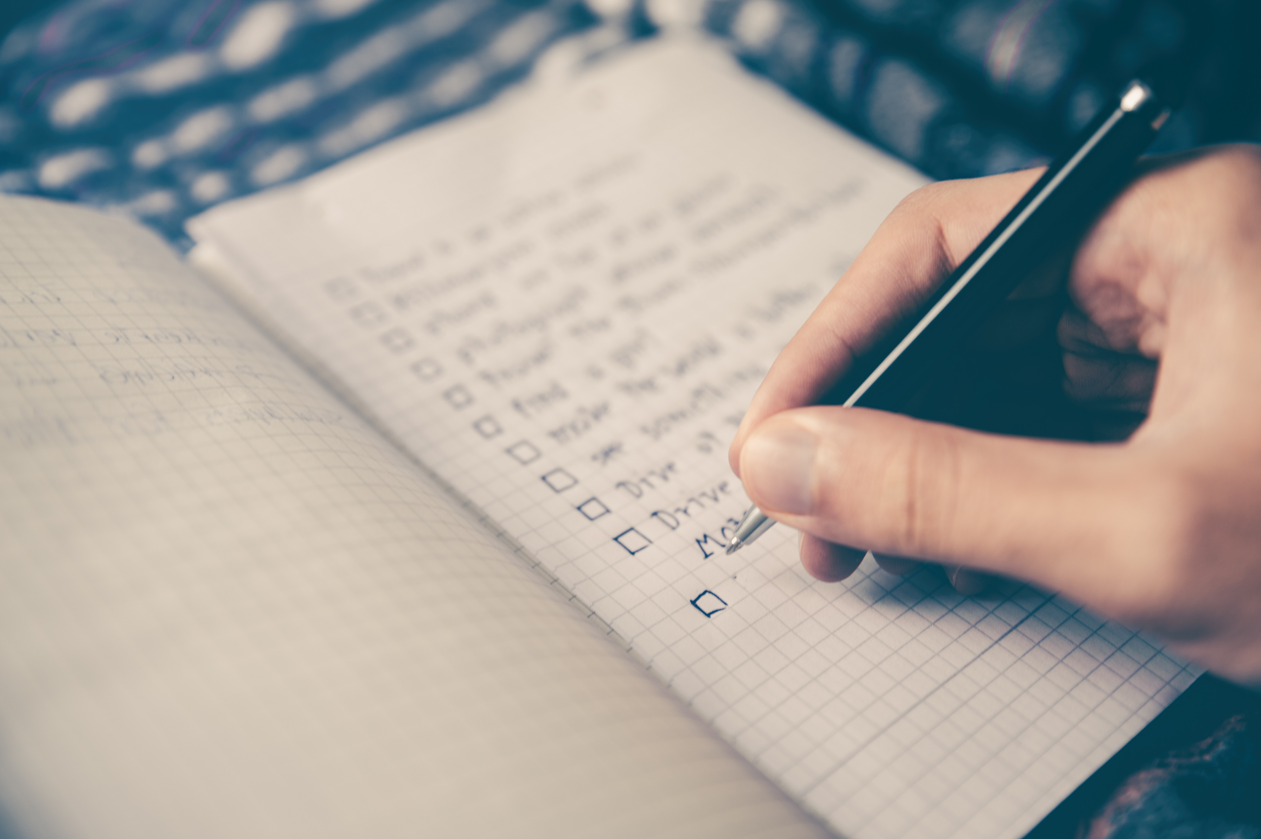 Checklist with pen and paper